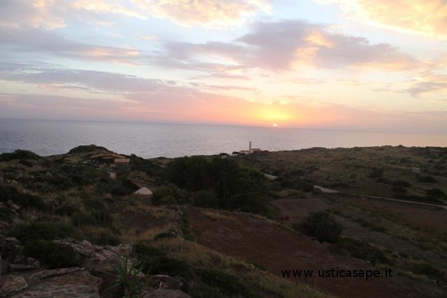 Ustica, tramonto con vista faro Punta Cavazzi